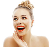Young blond woman with bright make up smiling pointing gesturing emotional isolated like doll lashes. Advertising concept Royalty Free Stock Images