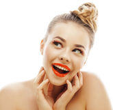 Young blond woman with bright make up smiling pointing gesturing emotional isolated like doll lashes Stock Photos