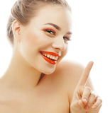 Young blond woman with bright make up smiling pointing gesturing emotional isolated like doll lashes on white. Advertising people concept Royalty Free Stock Photography