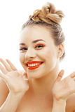 Young blond woman with bright make up smiling pointing gesturing emotional isolated like doll lashes on white Royalty Free Stock Photo