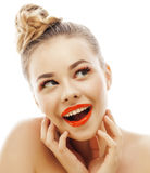 Young blond woman with bright make up smiling pointing gesturing emotional isolated like doll lashes on white Stock Photography