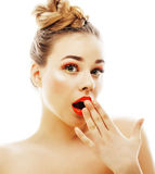 Young blond woman with bright make up smiling pointing gesturing emotional  like doll lashes. Close up Royalty Free Stock Photography