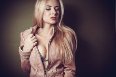 Young blond woman with bright makeup Stock Images
