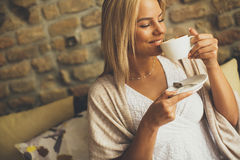 Young blond woman in the cafe Stock Images