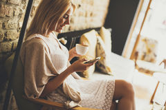Young blond woman in the cafe Royalty Free Stock Images