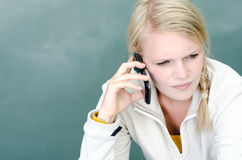 Young blond woman called up with her Smartphone Stock Photography
