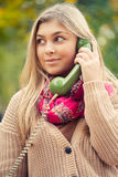 Young blond woman calling Royalty Free Stock Images