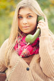 Young blond woman calling Royalty Free Stock Photos