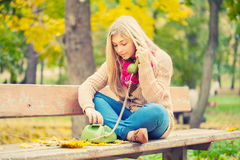 Young blond woman calling Royalty Free Stock Photography