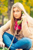 Young blond woman calling Stock Photo