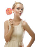 Young blond woman with candy Stock Photos
