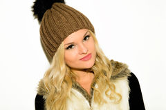Young blond woman in a cap and vest Royalty Free Stock Photo