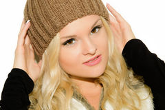 Young blond woman in a cap and vest Royalty Free Stock Image
