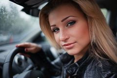 Young blond woman in car royalty free stock photos