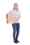 Young blond woman with cardboard moving box isolated on white Stock Photo