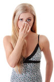 Young blond woman cleaing her face Stock Photography
