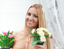 Young blond woman in a comfortable terrace Stock Photos
