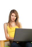 Young blond woman with computer Royalty Free Stock Photos