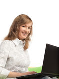 Young blond woman with computer Royalty Free Stock Photography