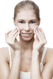 Young blond woman with cotton pad Stock Images