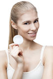 Young blond woman with cotton pad Stock Photography