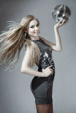 Young blond woman with disco ball Royalty Free Stock Photo