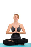Young blond woman doing yoga Stock Image