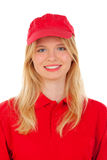 Young blond woman dressed dealer with red uniform Royalty Free Stock Photography