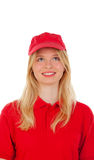 Young blond woman dressed dealer with red uniform Royalty Free Stock Images