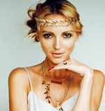 young blond woman dressed like ancient greek godess, gold jewelr royalty free stock photography