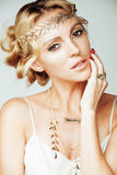 Young blond woman dressed like ancient greek godess, gold jewelry close up isolated Stock Images