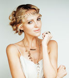 Young blond woman dressed like ancient greek godess, gold jewelry close up isolated Stock Photography