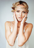 Young blond woman dressed like ancient greek godess, gold jewelry close up isolated Stock Photos