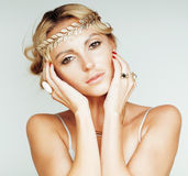 Young blond woman dressed like ancient greek godess, gold jewelry close up isolated Royalty Free Stock Image