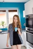Young blond woman drinking coffe or tea from the cup Royalty Free Stock Photo