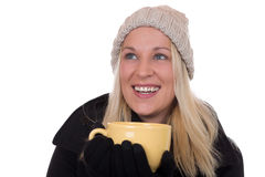 Young blond woman drinking cup of tea and looking up Stock Images