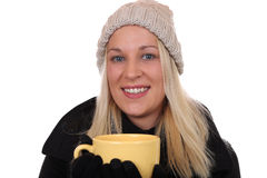 Young blond woman drinking cup of tea in winter Royalty Free Stock Photos