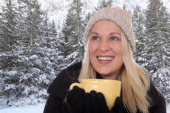 Young blond woman drinking outdoors in winter cup of tea Royalty Free Stock Photo