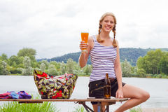 Young, blond woman drinking a wheat beer Stock Images