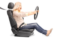 Young blond woman driving very fast Royalty Free Stock Images