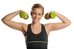 Young Blond Woman with dumbbells Stock Photography