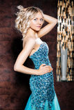 Young blond woman in an elegant dress Royalty Free Stock Images