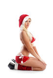 A young blond woman in erotic Christmas lingerie Royalty Free Stock Photo