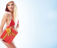 A young blond woman in erotic Christmas lingerie Royalty Free Stock Images