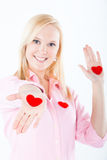 Young blond woman exposing hearts in her pams Royalty Free Stock Photos