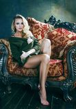 Young blond woman in fairy luxury interior with antique chair t royalty free stock photos