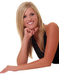 Young blond woman on floor smiling Royalty Free Stock Image