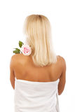 Young blond woman with flower Stock Photography