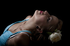 Young blond woman with flower in her hair. Close up of a beautiful woman with flower in her hair Stock Photos