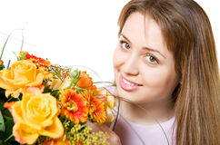 Young blond woman with flowers Stock Image